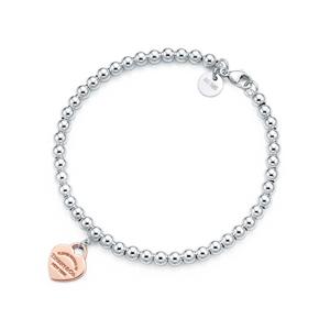Tiffany & Co. Luxusní stříbrný náramek s pozlaceným srdíčkovým přívěskem 30929209 + originální balení 6,5